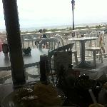 outdoor seating with a nice view of the boardwalk and ocean