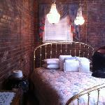 our bed and the beautiful brick walls!