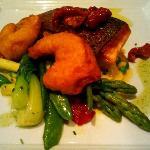 Roast Fillet of Salmon - Pea and saffron risotto with a prawn tempura, tomato & herb dressing