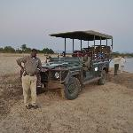 """Our Safari """"Bus"""" and Mishek, the guide we liked best."""