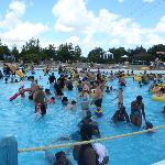 Many people in the wave pool