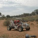 Norman and Trish flying by in a dune buggy