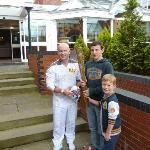 Olympic torch bearer at hotel entrance