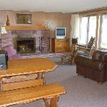 Family area with sleeper sofa, stocked fireplace and cable television.