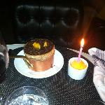 Chocolate and orange souffle with birthday candle