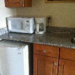 Kitchenette with granite countertop