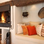 Enjoy breakfast on the enclosed patio by a log fire in winter