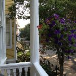 Deep front porch overlooking Whitaker St and Forsyth Park.