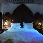 A large and comfortably bed in the Laaroussa suite