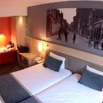 Comfy beds and wall art of historic Rue Saint Lambert