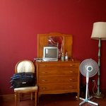 Had to use fan as air con didn't work, old fashioned tv and wonky lamp