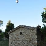 La Capanna with hot air balloon passing early morning