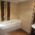 spacious bathroom with jacuzzi