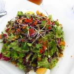 Mixed salad with french dressing and sunflower seeds
