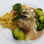 Sauteed venison with juniper cream sauce, mushrooms, broccoli, and spatzle