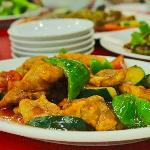Sweet and sour pork with crisp bell pepper slices and tender breaded pork