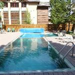 The pool, outdoor & heated, there is a big hot tub next to it. They provided towels