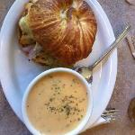 Chicken artichoke and pesto on a croissant, broccoli cheddar soup