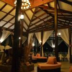 Part of the lobby and entrance to the restaurant at night.