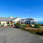 Large car park facility with outdoor seating in beautiful surrounding beside the sea
