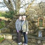 Me and my sister in front of a water feature in the rear of the lodge