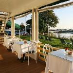 Enjoy breakfast in our wrap-around porch with an ocean view