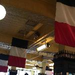 The flags and tin ceiling at the Can Can.