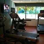 small but really nice exercise room over looks pool and each treadmill has it's own tv.