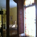 A view of the beautiful antique armoire and the door leading to my private balcony.