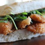 Fish finger sandwich with rocket and lemon mayo