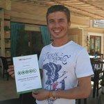 Yusuf,owner of Aqua Bar with his Trip Advisor certificate