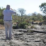 Bush walk. Me watching rhinos on the back