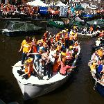Boats on Prinsengracht during Queens Day celebrations