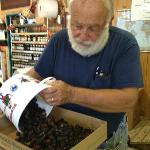 Owner Dennis Fox weighs our berries!