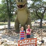 My grand daughters in front of the dinosaur that was donated from Hollywood.