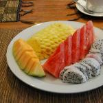 Some breakfast fruit (cantaloup, watermelon, pineapple, and dragon fruit).