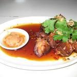Crispy pork hock with plum caramel and thai chilli sauce