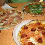 White sauce pizza, diavolla and rocket and seafood pizzas