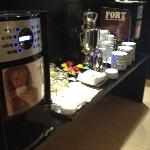 The coffee machine with lots of coffee cakes and biscuits