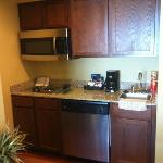 fully stocked kitchen & full size refrigerator