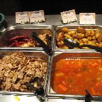Halal Meat, chicken & sausages, potatoes, vegetables in sauce.