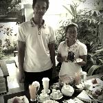 Friendly and warm staff serving breakfast to our villa