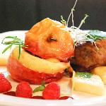 Duck with raspberry sauce and apples