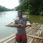 posing on the wooden raft