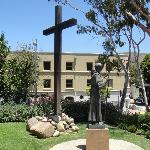 Statue of Fray Junípero Serra stands outside in the garden