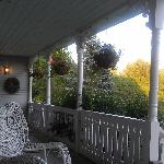 The front porch at twilight; this shows about 1/3 of the sitting area.