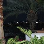 Outdoor view of the patio and bridge a night.