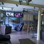 """the """"great room"""" common area. lots of tv's and plush leather seating! football too!"""