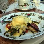 Delicious Eggs Benedict with asparagus and croissant