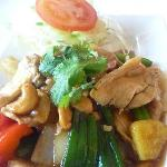 Chicken with cashew nuts .